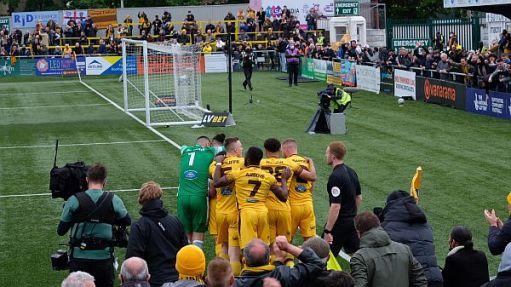 Team celebrating their third goal.