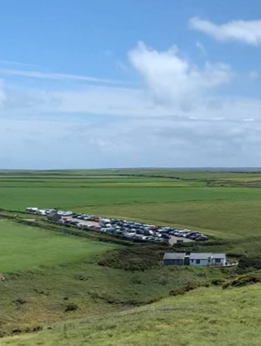 Marloes Peninsular. National Trust Car Park for day trips from Martin's Haven to Skomer. In front: Lockley Lodge.