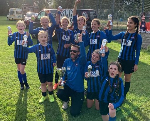 We won the cup! Worthing Town Ladies Under 12, with coach Andy.