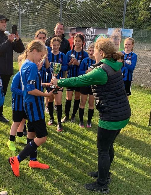 Captain Daisy receives the cup for the Team.