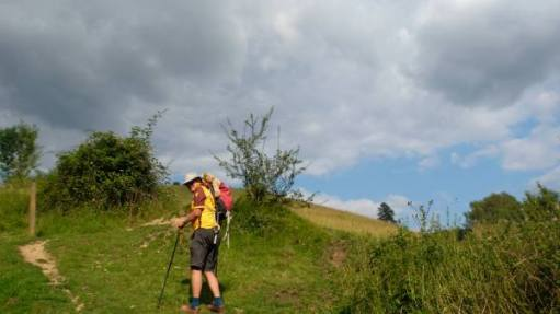 Photo of Bobby climbing Swift's Hill with Bertie in has rucksack!