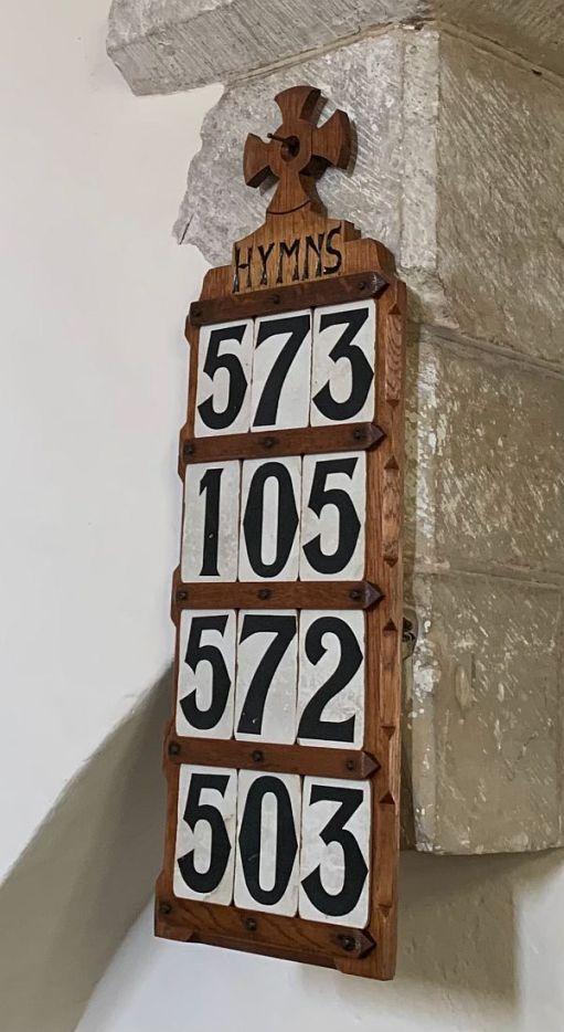 The hymn board.