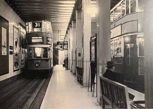 Two double-deck trams at Aldwych tram stop.