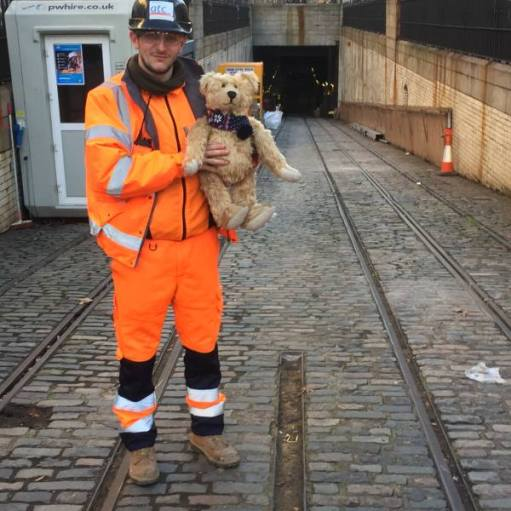 Bertie posing with a Crossrail worker at the entrance to the Kingsway Tram Tunnel.