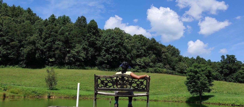 Girl sitting at the lake
