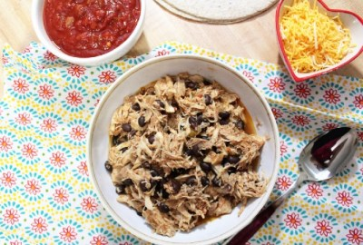 This simple Crockpot Mexican Chicken combines chicken, salsa and black beans. It can be used for tacos, burritos or burrito bowls among other things.