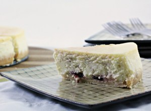 Raspberry Cheesecake only requires 8 ingredients and features a shortbread cookie crumb crust and a creamy center with sweet raspberry preserves.