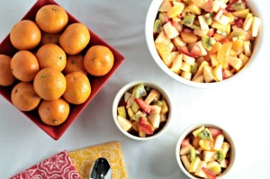 Refreshing Winter Fruit Salad features red and green apple, kiwi, strawberry, pineapple, and mandarin oranges topped with a honey lemon dressing. Healthy!