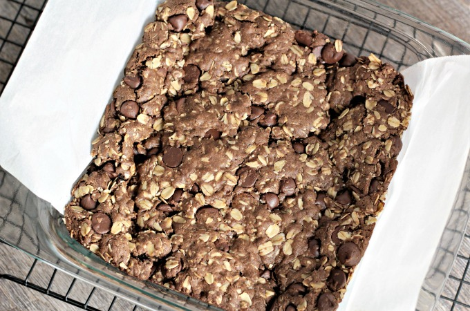 Chocolate Chocolate Chip Oatmeal Bars feature cocoa, oats, and chocolate chips to make this rich, dense and delicious cookie bar.