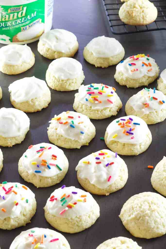 Glazed Sour Cream Cookies are soft and fluffy cake like cookies that are sure to become a favorite for holidays and parties all year around.