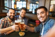 53713720-people-leisure-friendship-technology-and-bachelor-party-concept-happy-male-friends-taking-selfie-and