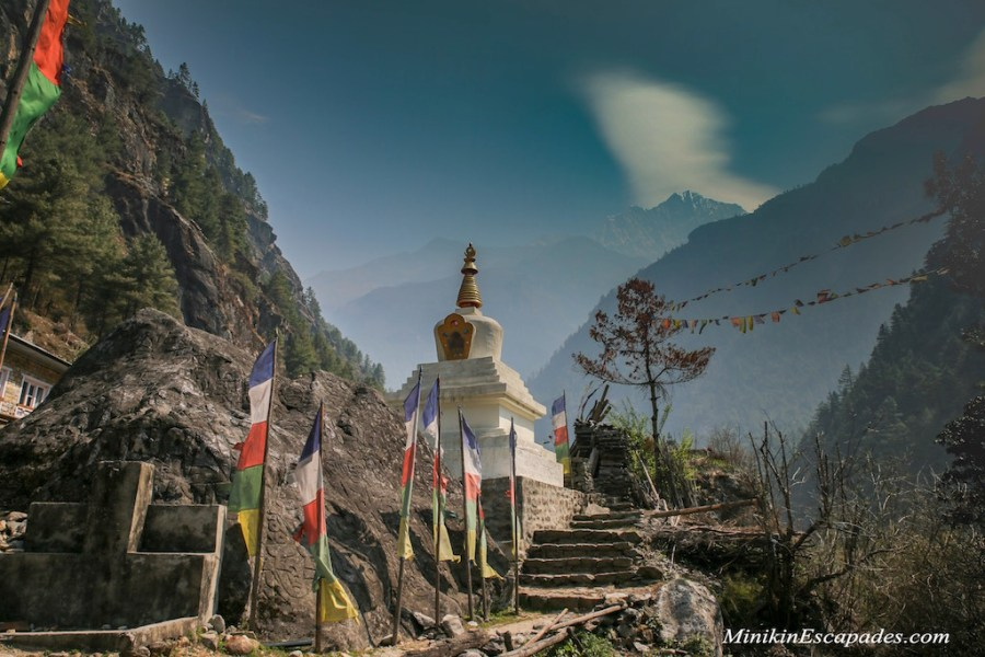 A stupa and colorful prayer flags, Nepal