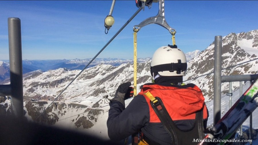 Harnessed on the cables of the highest zilpline in french alps