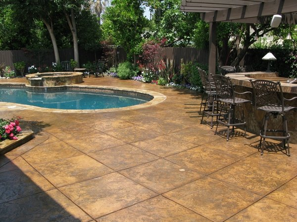 Stamped concrete adds depth and beauty to the exterior on Pool Deck Patio Ideas id=55346