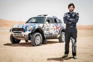 MINI UK new motorsports ambassador Harry Hunt with his Dakar Car win podium place at the Abu Dhabi Desert Challenge in April 2015