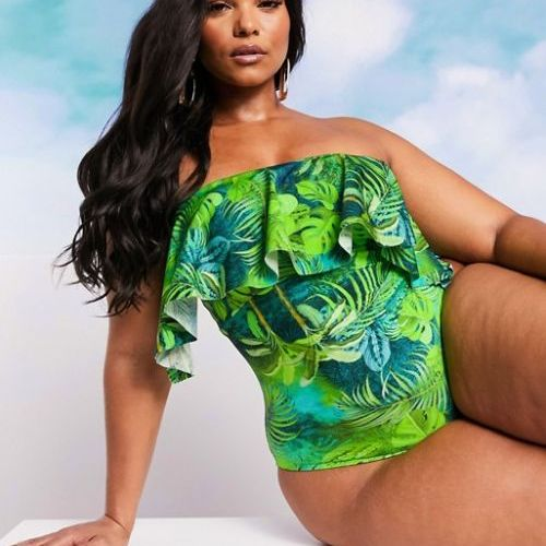 Cute swimsuits ASOS DESIGN CURVE SWIM GLAM bandeau overlay frill swimsuit in exotic palm print CREDIT ASOS