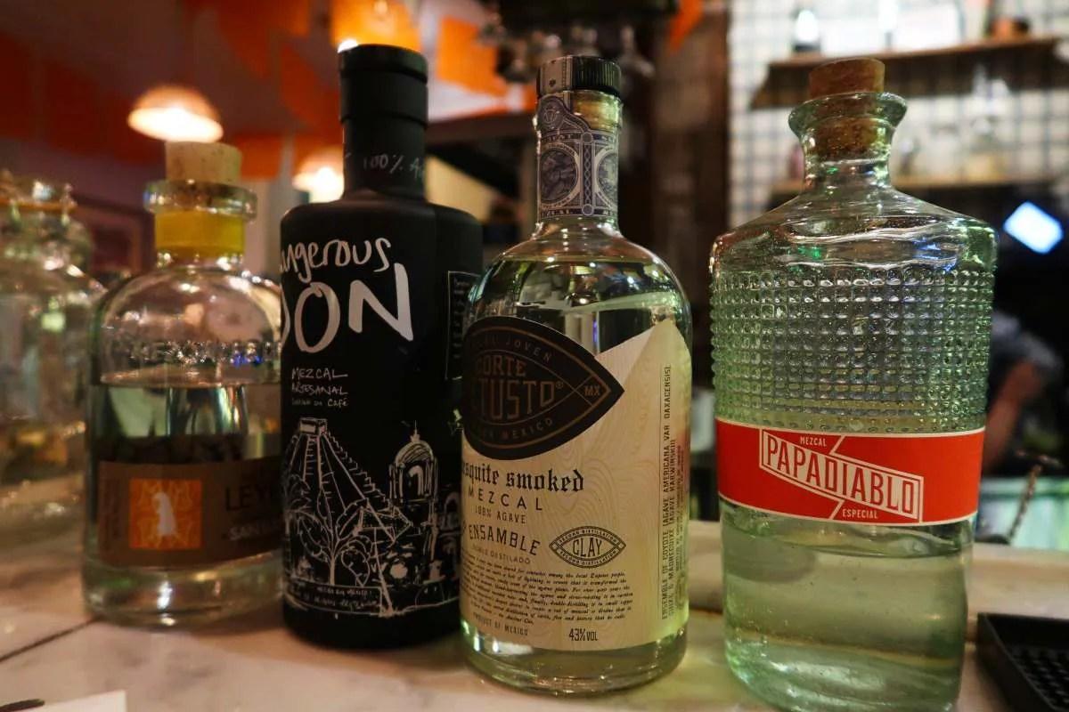 Mezcal London - Santo Remedio - mezcal bottles CREDIT Minka Guides