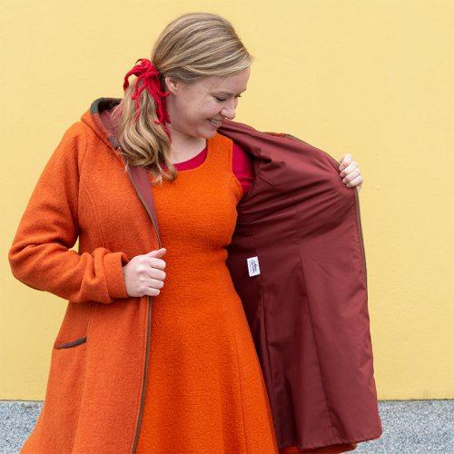 Oranssi puuvillavuorillinen villakangastakki hupulla, A-linjainen helma