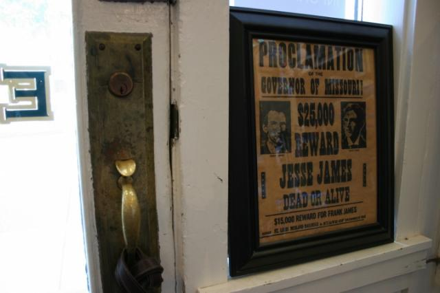A copy of a wanted poster posted next to the front door of the museum.