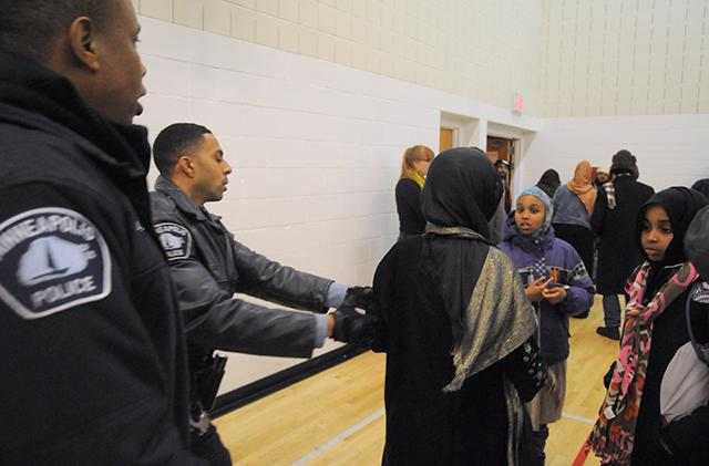 An unidentified woman being handcuffed by police