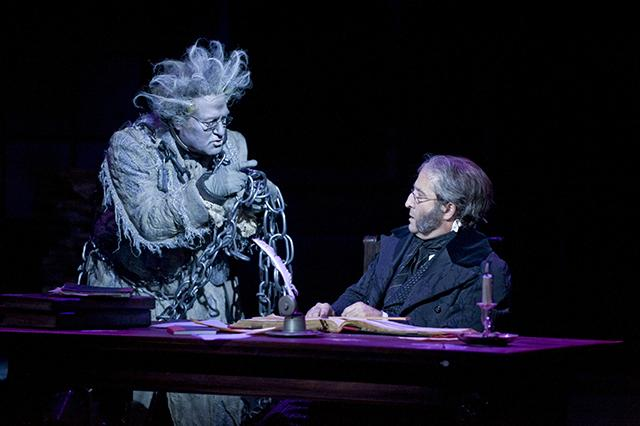 Bob Davis (Jacob Marley) and J.C. Cutler (Ebenezer Scrooge) in the Guthrie Theat