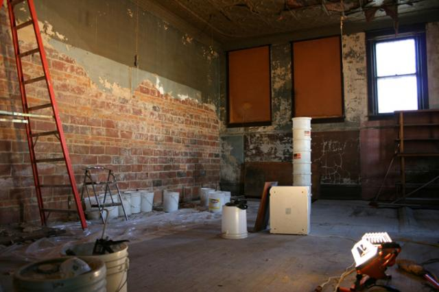 The back room, with focal point brick walls, will become an entertainment venue