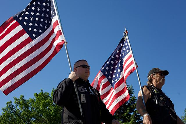 men with american flags