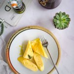 Japanese Omelette also known as Tamagoyaki - served for breakfast on a white porcelain plate