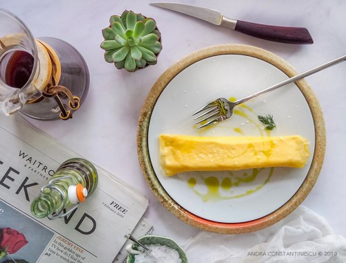 Japanese rolled omelette - also known as tamagoyaki - served for breakfast on a white plate