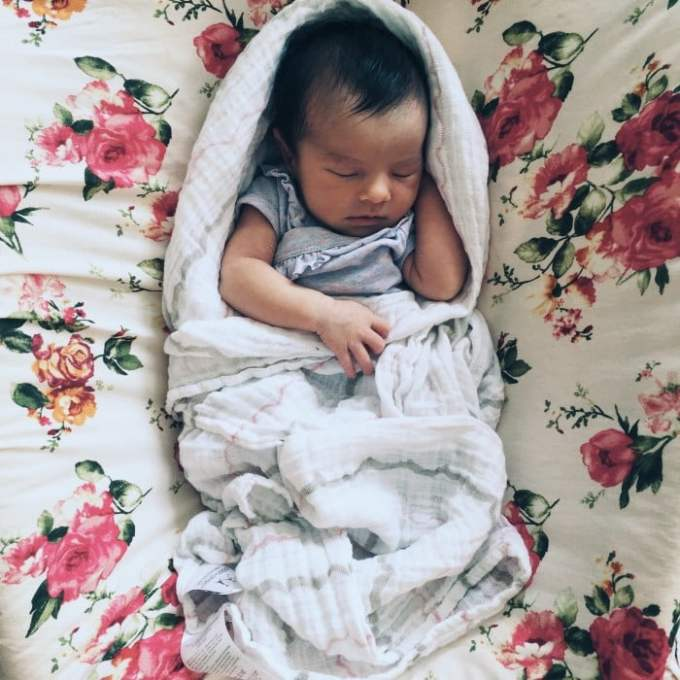 baby in fisher price rock-n-play, the best little mobile sleeper or baby bassinet. Only weighs 8 pounds and folds flat for travel! A MUST HAVE for any new mom
