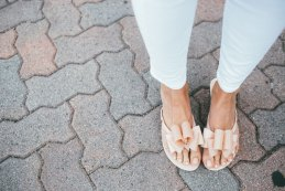 pink Melissa Sandals with pink top and white pants