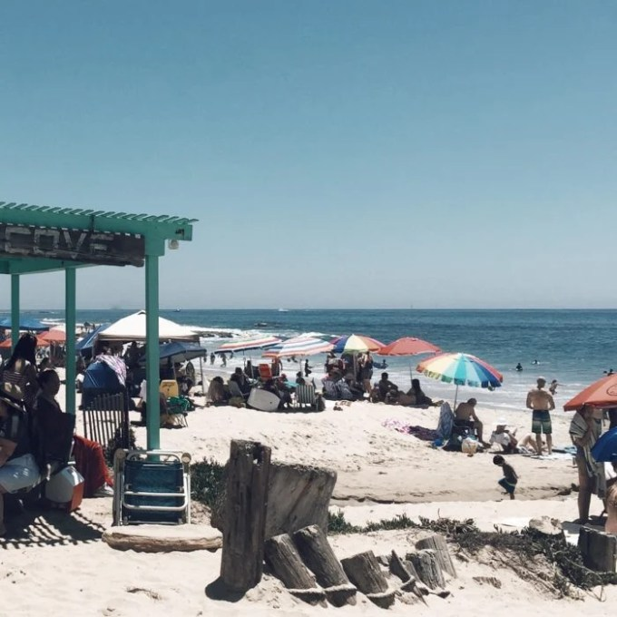busy summer day at the beach with summer shade