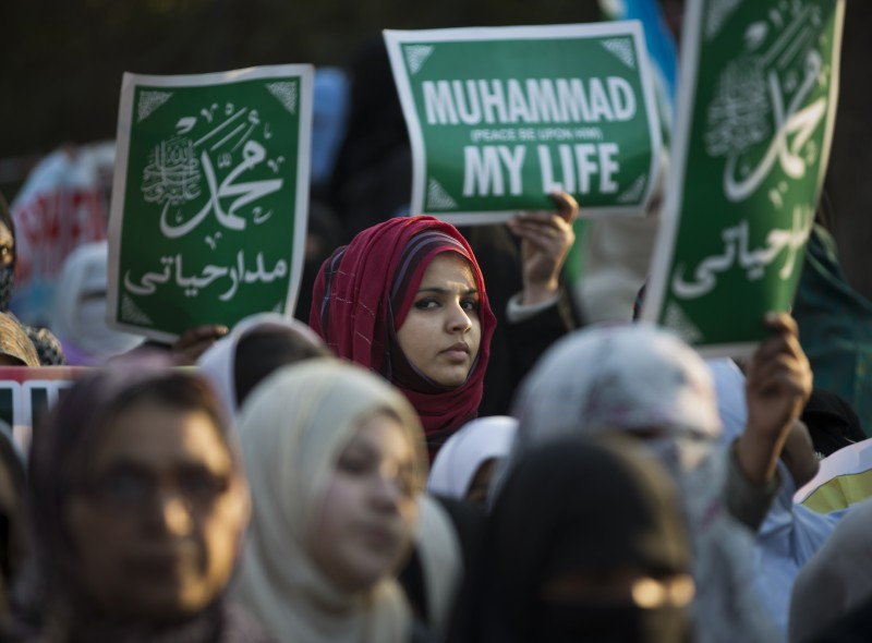 Supporters of the Pakistani religious political party Jamaat-e-Islami attend a rally to condemn the French satirical weekly magazine Charlie Hebdo for publication of caricatures of the Prophet Muhammad, in Islamabad, Pakistan, Friday, Jan. 30, 2015. (AP Photo/B.K. Bangash)