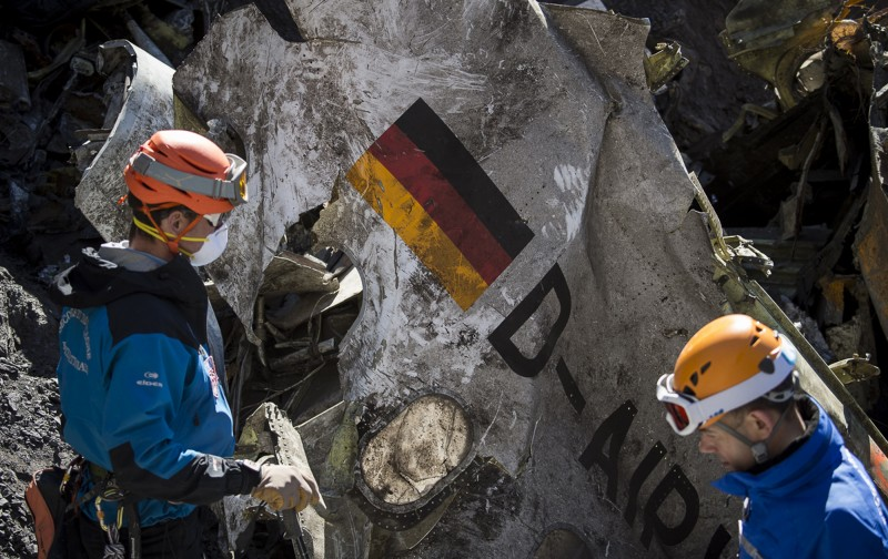"In this photo taken on Tuesday, March 31, 2015 and provided by the French Interior Ministry, French emergency rescue services work among debris of the Germanwings passenger jet at the crash site near Seyne-les-Alpes, France. Comparing the treatment of the killer Germanwings pilot Andreas Lubitz to that of France's ""terrorist"" Muslim killers reveals much about the mainstream media's assumptions and prejudices. (AP Photo/Yves Malenfer, Ministere de l'Interieur)"