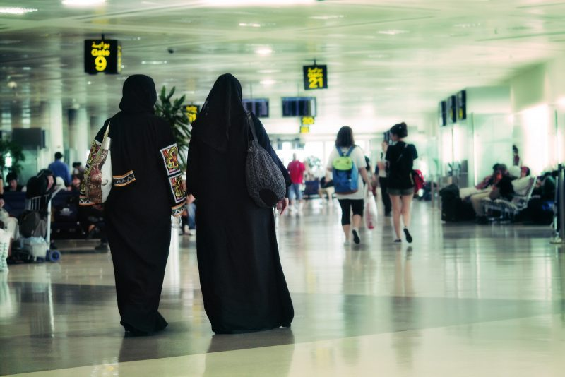 Women walk through an airport in Doha, Qatar on June 30, 2010. Two of the women are wearing niqab. (Flickr / Juanedc.com)