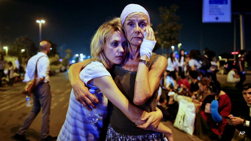 Passengers embrace each other as they wait outside Istanbul's Ataturk airport, early Wednesday, June 29, 2016 following their evacuation after a blast. Suspected Islamic State group extremists have hit the international terminal of Istanbul's Ataturk airport, killing dozens of people and wounding many others, Turkish officials said Tuesday. (AP Photo/Emrah Gurel) TURKEY OUT