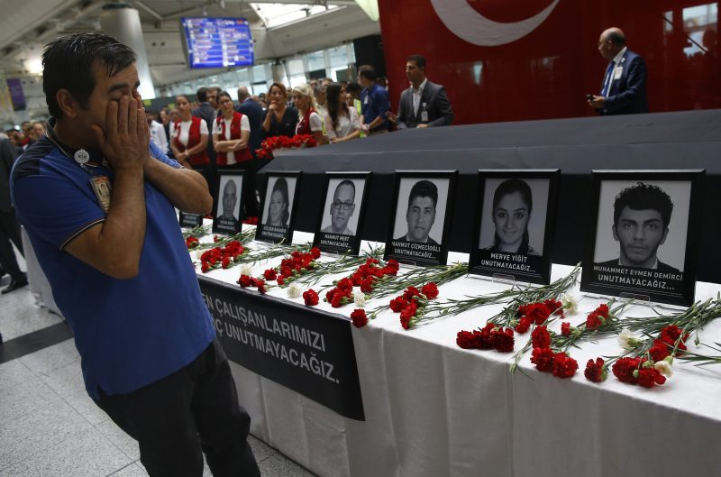 In this Thursday, June 30, 2016 photo, family members, colleagues and friends of the victims of Tuesday blasts gather for a memorial ceremony at the Ataturk Airport in Istanbul. As millions of Muslims around the world celebrate the end of Ramadan, many are struggling to come to grips with what has been a particularly bloody month of attacks that killed more than 350 people and spread terror across continents. (AP Photo/Emrah Gurel, File)