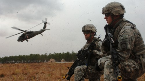 Two military policemen in Fort Bragg, North Carolina, December 2010. Current active-duty U.S. service members are among those with opinions about the recent debate for a strike in Syria. (Photo/DVIDSHUB via Flickr)