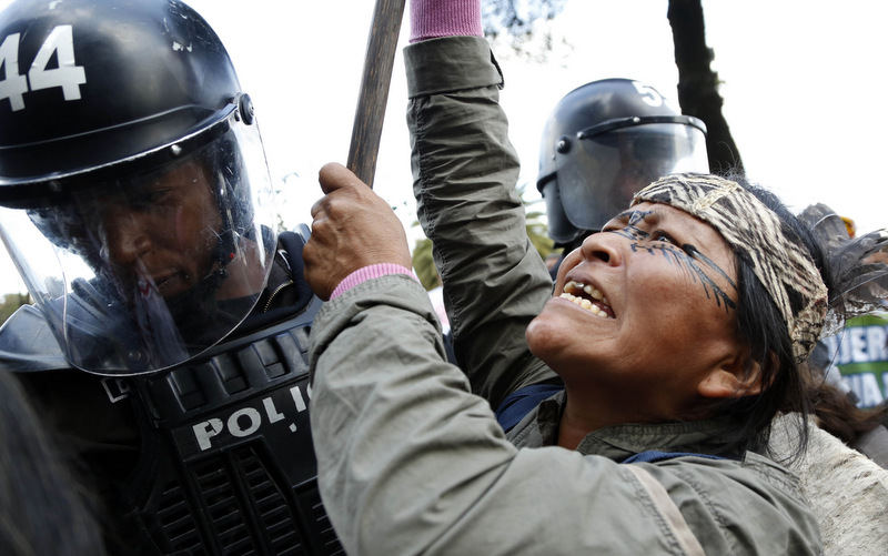 An indigenous woman confronts police