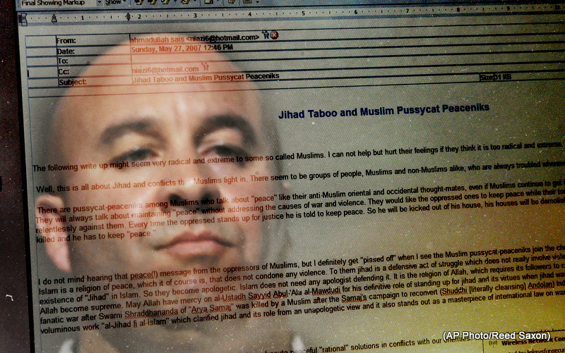 """Craig Monteilh, who says he infiltrated Southern California mosques as an FBI informant and wants to clear his name of suspicions he might have promoted terrorist activities, is reflected in a computer-screen image of an e-mail from Ahmadullah Sais Niazi titled """"Jihad Taboo and Muslim Pussycat Peaceniks,"""" in Irvine, Calif., Tursday, Feb. 26, 2009. (AP Photo/Reed Saxon)"""