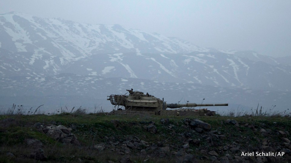 An old Israeli tank sits in a position in the Israeli-controlled Golan Heights near the border with Syria,Tuesday, Jan. 27, 2015.
