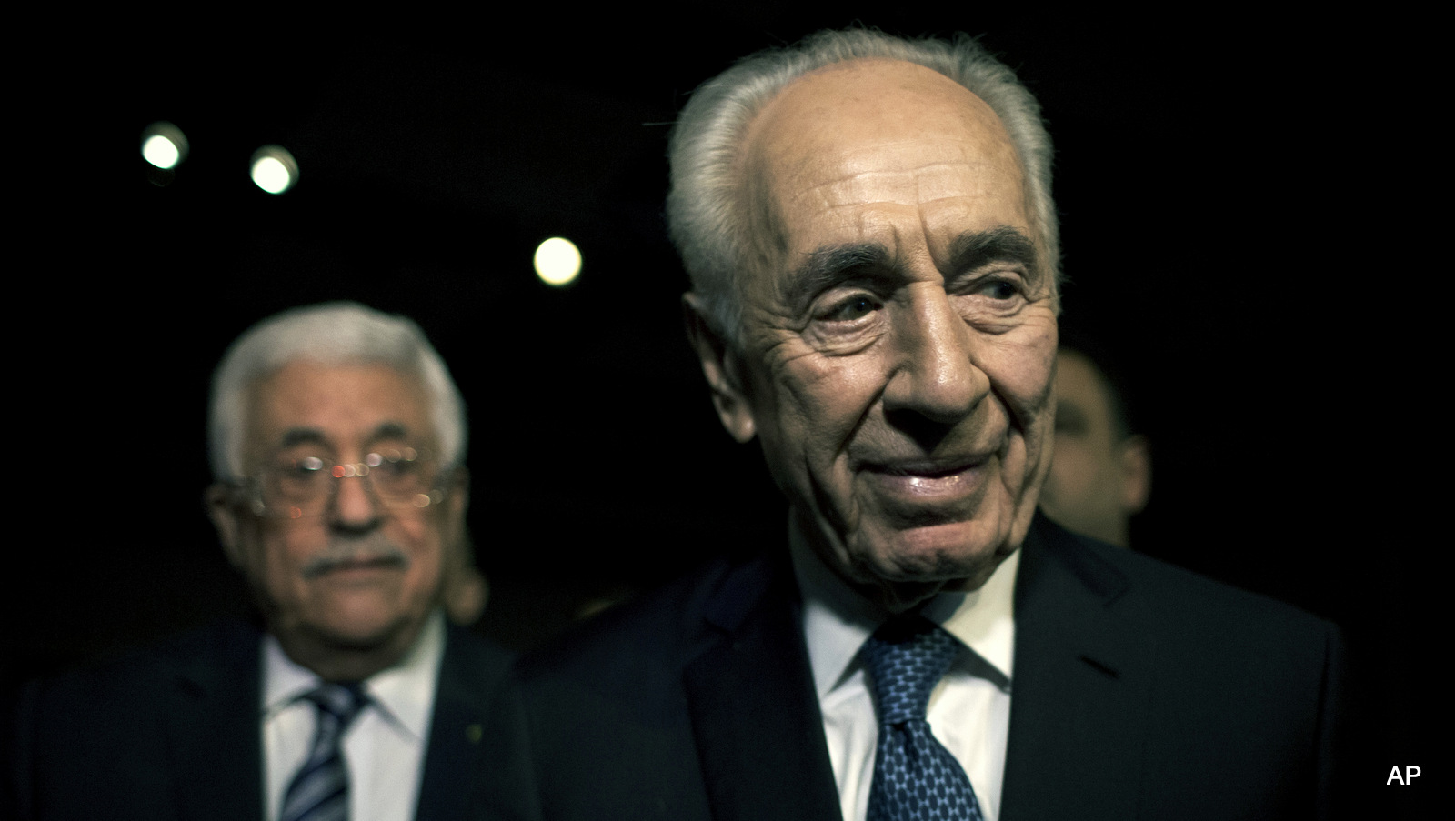 Former Israeli President Shimon Peres, right and Palestinian President Mahmoud Abbas arrive to attend the opening session of the World Economic Forum at the King Hussien convention center, Southern Shuneh, Jordan, Friday, May 22, 2015. Palestinian President Mahmoud Abbas on Friday said Israel is blocking peace by continuing to expand settlements on occupied territory, but reaffirmed his support for a two-state solution based on the pre-1967 border.