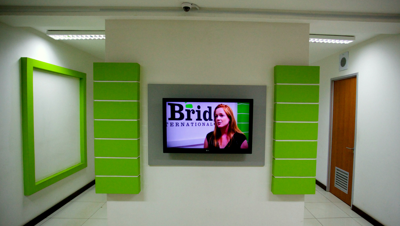Bridge co-founder Shannon May on a video monitor in the company's Nairobi headquarters.  (Frederic Courbet/NPR)