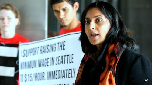 Seattle City Council Kshama Sawant, right, speaks outside City Council chambers in Seattle