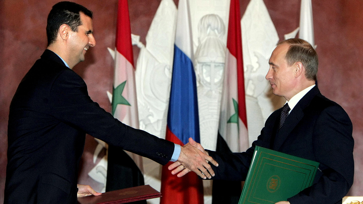 Syrian President Bashar Al Assad (left) and his Russian counterpart Vlamidir Putin (right)
