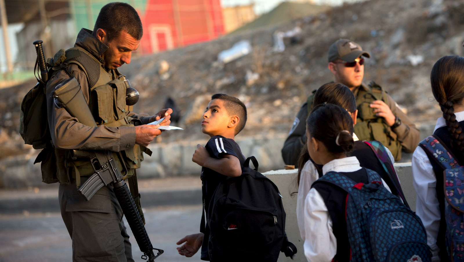Israeli border police check Palestinian's identification cards at a checkpoint in Jerusalem, Thursday, Oct. 22, 2015.Palestinian right's groups are calling for people to remember the longstanding occupation that has again sparked recent violence. (AP Photo/Oded Balilty)