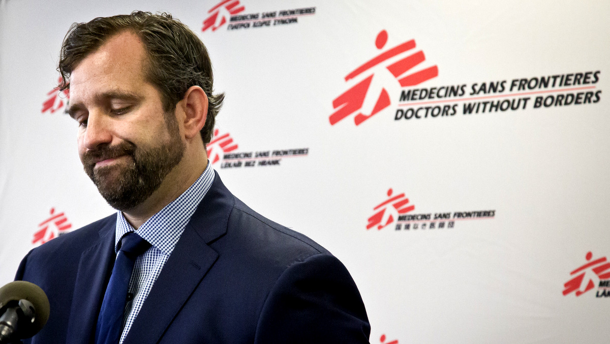 Jason Cone, U.S. executive director of Doctors Without Borders, pauses as he speaks during a press conference Wednesday, Oct. 7, 2015, in New York calling for an independent, international investigation into the U.S. air strike on a hospital in Afghanistan that killed at least 22 people. (AP Photo/Bebeto Matthews)