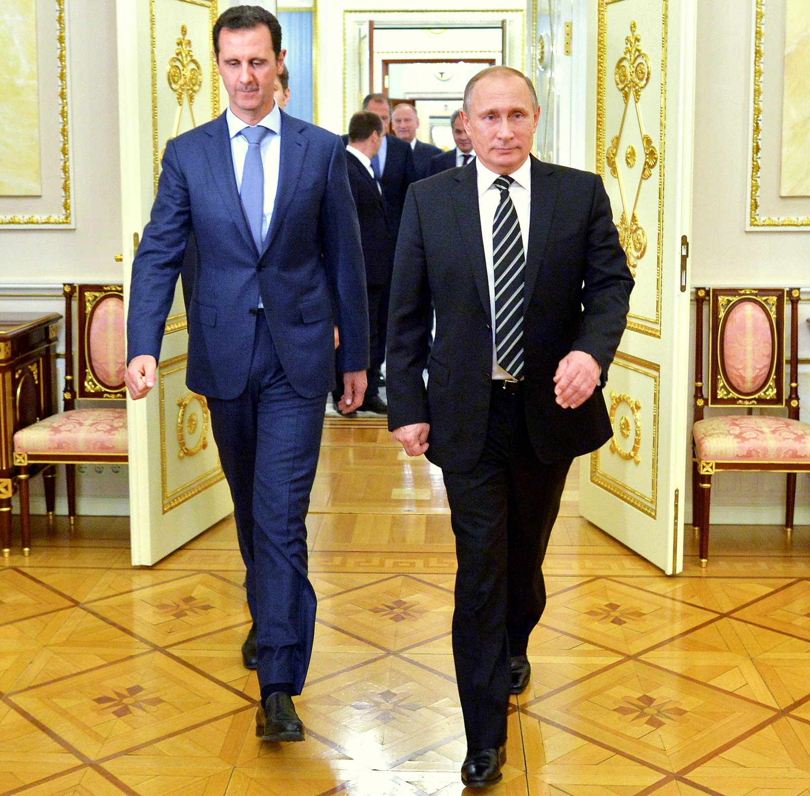 In this photo taken on Tuesday, Oct. 20, 2015, Russian President Vladimir Putin, right, and Syria President Bashar Assad arrive for their meeting in the Kremlin in Moscow, Russia. President Bashar Assad was in Moscow, in his first known trip abroad since the war broke out in Syria in 2011, to meet his strongest ally Russian leader Vladimir Putin. The two leaders stressed that the military operations in Syria_ in which Moscow is the latest and most powerful addition_ must lead to a political process. (Alexei Druzhinin, RIA-Novosti, Kremlin Pool Photo via AP)