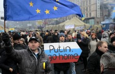 People gather during a rally in Kiev's Independence Square to protest Russia's involvment in Ukraine and Crimea. AP Photo/Sergei Chuzavkov)