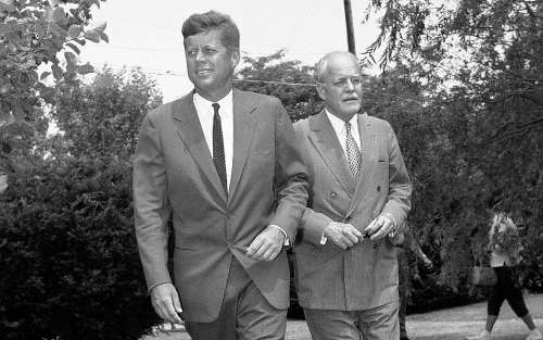 Sen. John F. Kennedy, (left), and Allen W. Dulles, Central Intelligence Agency (CIA) director, walks towards newsmen on the lawn of the Democratic presidential candidates in Hyannis Port, MA., home on July 23, 1960. AP